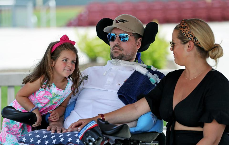 Pete Frates with wife Julie and 4-year-old daughter, Lucy, at the dedication of the Pete Frates Center at Boston College.