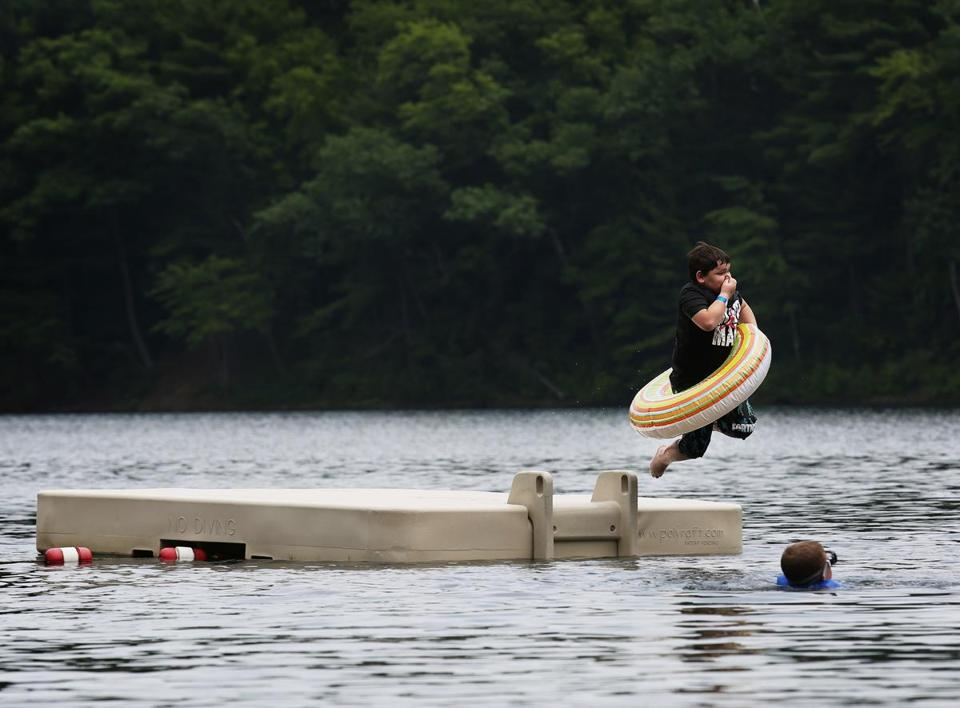 DEVENS, MA - 06/29/2019 A boy jumps into Mirror Lake on a Saturday afternoon. Erin Clark for The Boston Globe