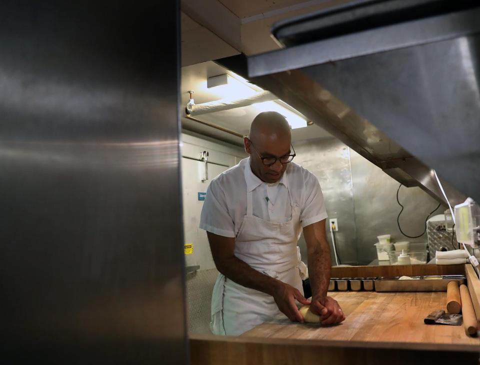 Williams makes pasta in the kitchen at MIDA.