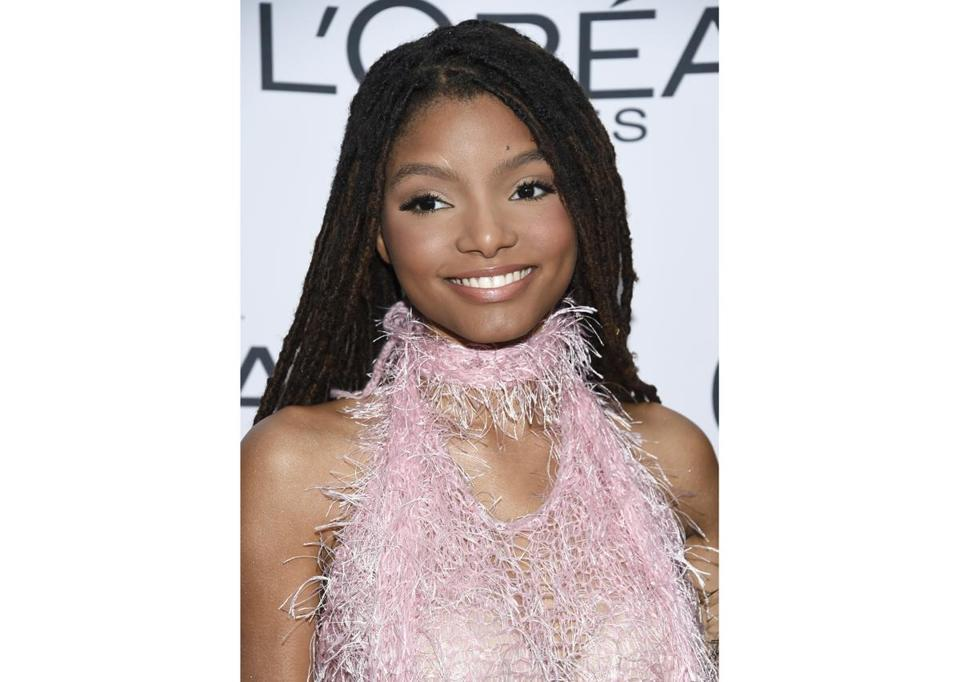 "FILE - This Nov. 13, 2017 file photo shows singer-actress Halle Bailey at the 2017 Glamour Women of the Year Awards in New York. Bailey, half of the sister duo Chloe x Halle, will next be going under the sea, starring as Ariel in the upcoming adaptation of ""The Little Mermaid."" The live-action version will include original songs from the 1989 animated hit as well as new tunes from original composer Alan Menken and ""Hamilton"" creator Lin-Manuel Miranda. (Photo by Evan Agostini/Invision/AP, File)"