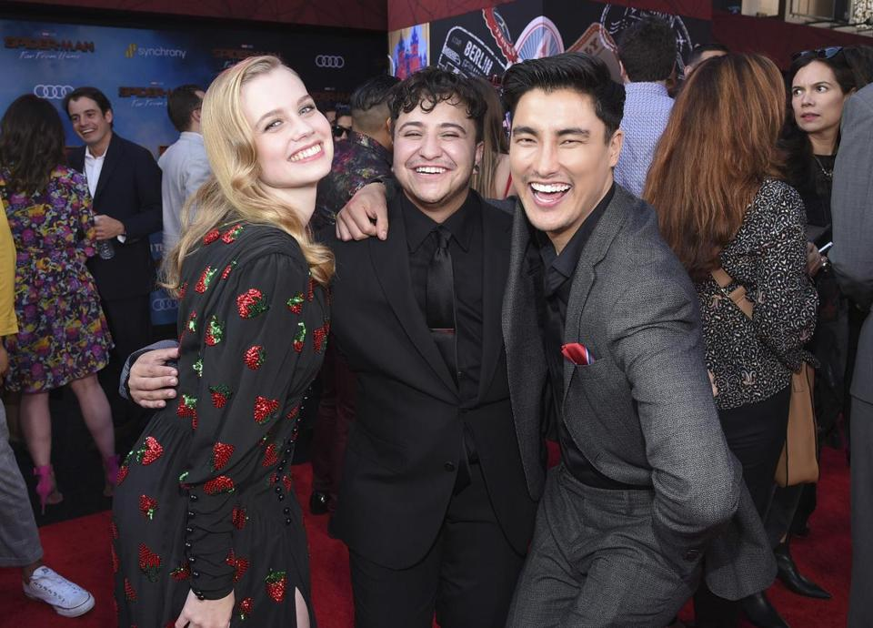 "This June 26, 2019 photo released by Sony Pictures shows, from left, Angourie Rice, Zach Barack and Remy Hii at the world premiere of ""Spider-Man: Far From Home"" at the TCL Chinese Theatre in Los Angeles. Barack, who plays the first openly transgender actor in the Marvel Universe, says there needs to be more express representation of his experience. Superhero movies ""always felt like a trans story because it's talking about identity,"" said Barack at last month's premiere of ""Spider-Man: Far From Home,"" in which he plays a classmate of Peter Parker's. His gender identity is not addressed in the movie. (Stewart Cook/Sony Pictures via AP)"