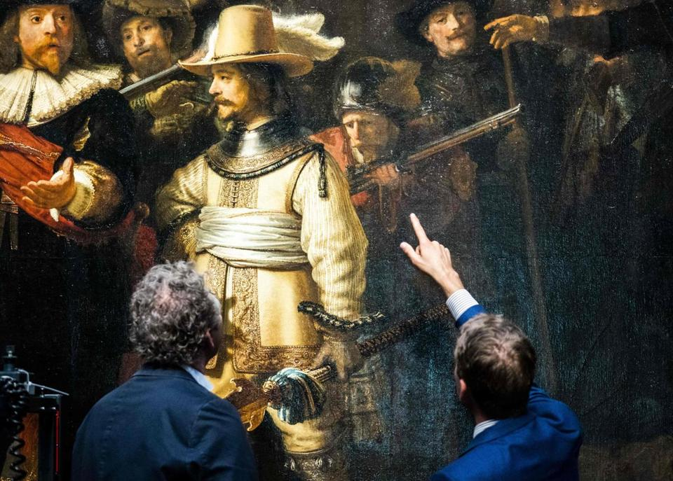 "Restorers look at Rembrandt van Rijn's world-famous masterpiece ""the Night Watch"" (1642) in Amsterdam, on July 8, 2019. - Amsterdam's famed Rijksmuseum began a historic restoration of Rembrandt's ""The Night Watch"" on July 8, 2019, erecting a huge glass cage around the painting so the public can see the work carried out live. The last major restoration work was carried out 40 years ago. (Photo by Freek van den Bergh and FREEK VAN DEN BERGH / ANP / AFP) / RESTRICTED TO EDITORIAL USE - MANDATORY MENTION OF THE ARTIST UPON PUBLICATION - TO ILLUSTRATE THE EVENT AS SPECIFIED IN THE CAPTIONFREEK VAN DEN BERGH/AFP/Getty Images"