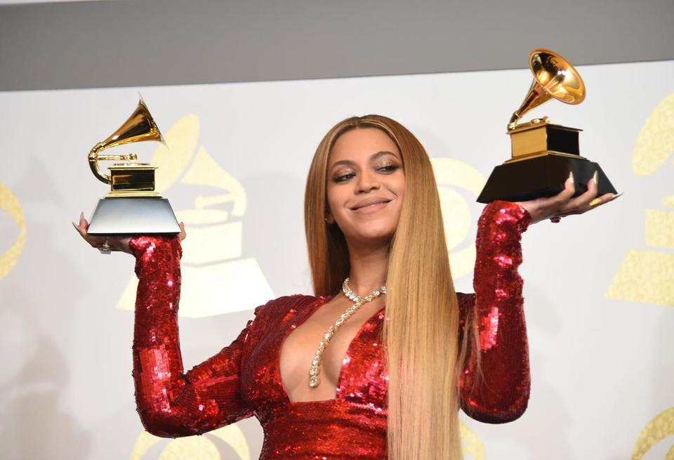 (FILES) In this file photo taken on February 12, 2017 Singer Beyonce poses with her Grammy trophies in the press room during the 59th Annual Grammy music Awards on February 12, 2017, in Los Angeles, California. - Beyoncé on April 17, 2019 has released her Netflix concert film, and surprised the world again by dropping an unexpected Homecoming album. Both the film and the album, also titled Homecoming, capture Beyoncés performance at last years Coachella Valley Music and Arts Festival. (Photo by Robyn BECK / AFP)ROBYN BECK/AFP/Getty Images