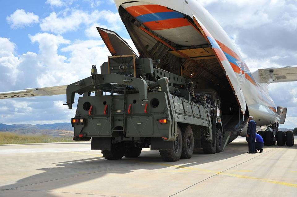 A handout photograph taken and released on Friday by the Turkish Defence Ministry showed a Russian military cargo plane carrying the S-400 missile defense system from Russia to the Murted military airbase in Ankara.