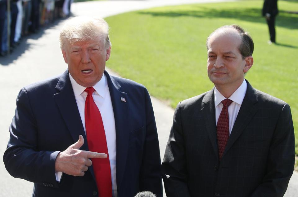 President Donald Trump stood with Labor Secretary Alex Acosta, who announced his resignation while talking to the media at the White House.