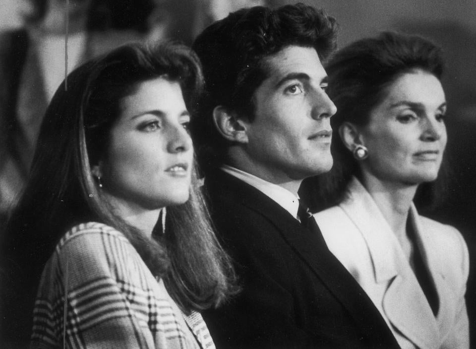 John F. Kennedy Jr. with sister, Caroline, and mother, Jackie, in 1989.