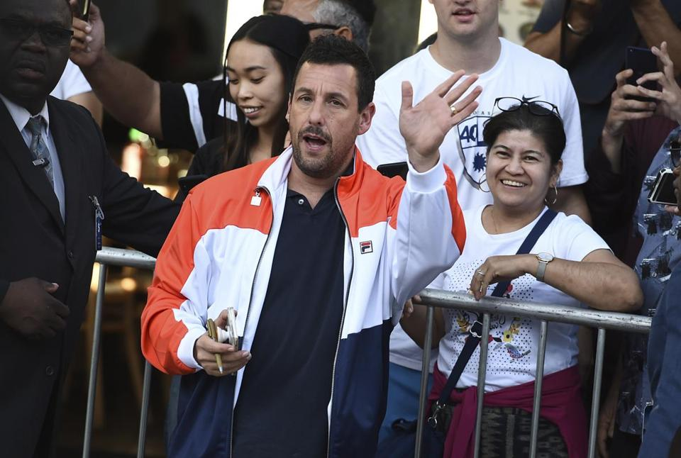 "Cast member Adam Sandler arrives at the Los Angeles premiere of ""Murder Mystery,"" at the Regency Village Theatre on Monday, June 10, 2019, in Westwood, Calif. (Photo by Jordan Strauss/Invision/AP)"