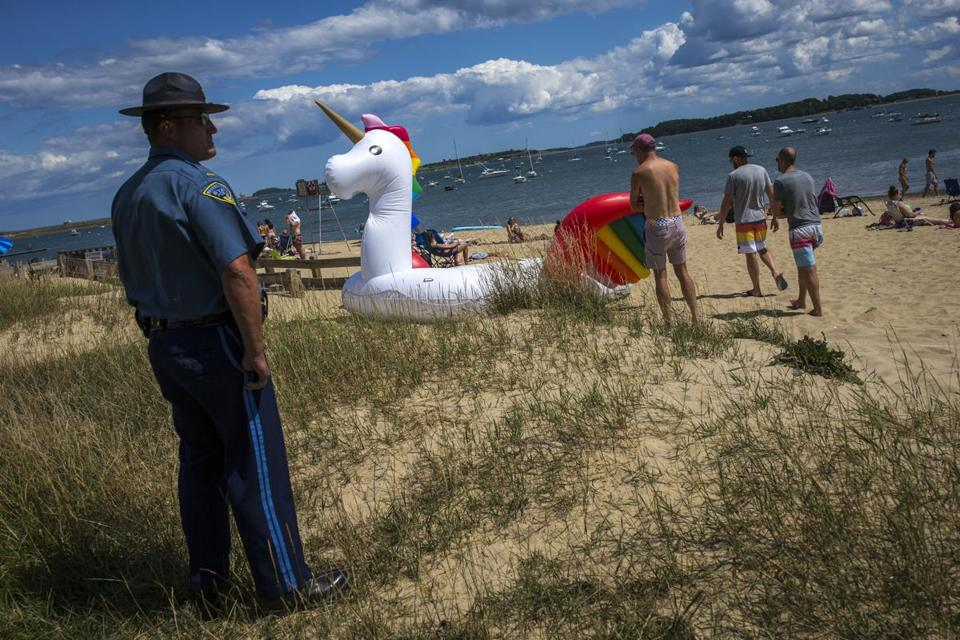 State Police Lieutenant Sean Newman ordered beachgoers to remove their inflatable unicorn from M Street Beach.