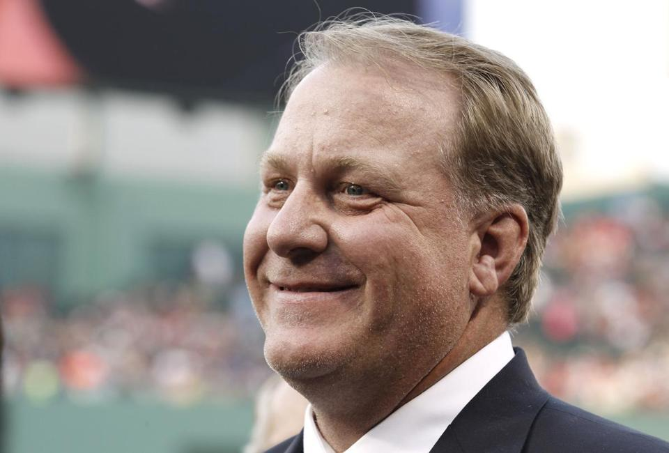 "FILE - This Aug. 3, 2012, file photo, shows former Boston Red Sox pitcher Curt Schilling smiling after being introduced at Fenway Park in Boston. Schilling says he's thinking about running for Congress in Arizona. Schilling confirmed in an email to The Arizona Republic on Monday, Aug. 12, 2019, that he's considering a run. He declined to say which district he'd run in and wrote that ""the illegal immigration issue is not a joke."" (AP Photo/Winslow Townson, File)"