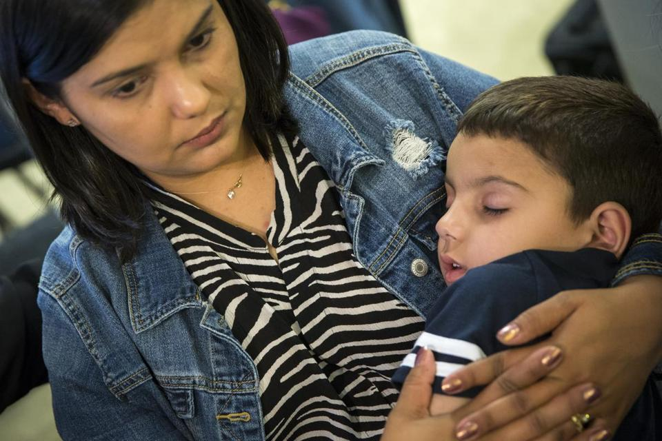 Sirlen Costa of Brazil held her ill son, Samuel, after a press conference in Boston this week.