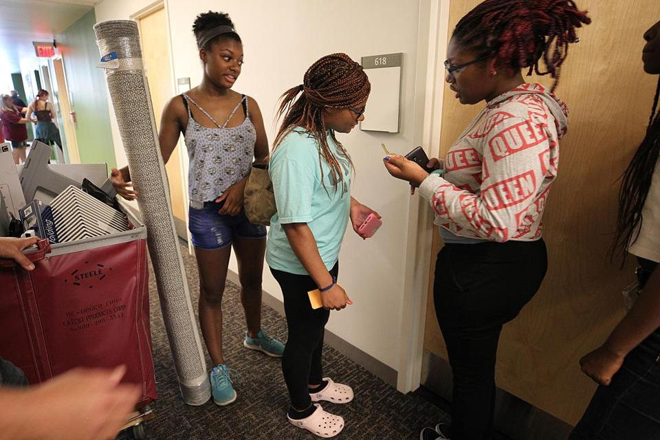 Incoming freshman Deanna Cook (center) couldn't get into her dorm room because of a broken key.