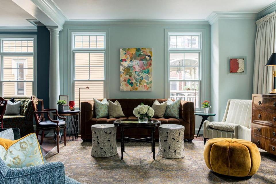 """I don't think we'd ever do two sofas in matching colors,"" says designer Tom Egan of selecting a brown one and a blue one for the living room."