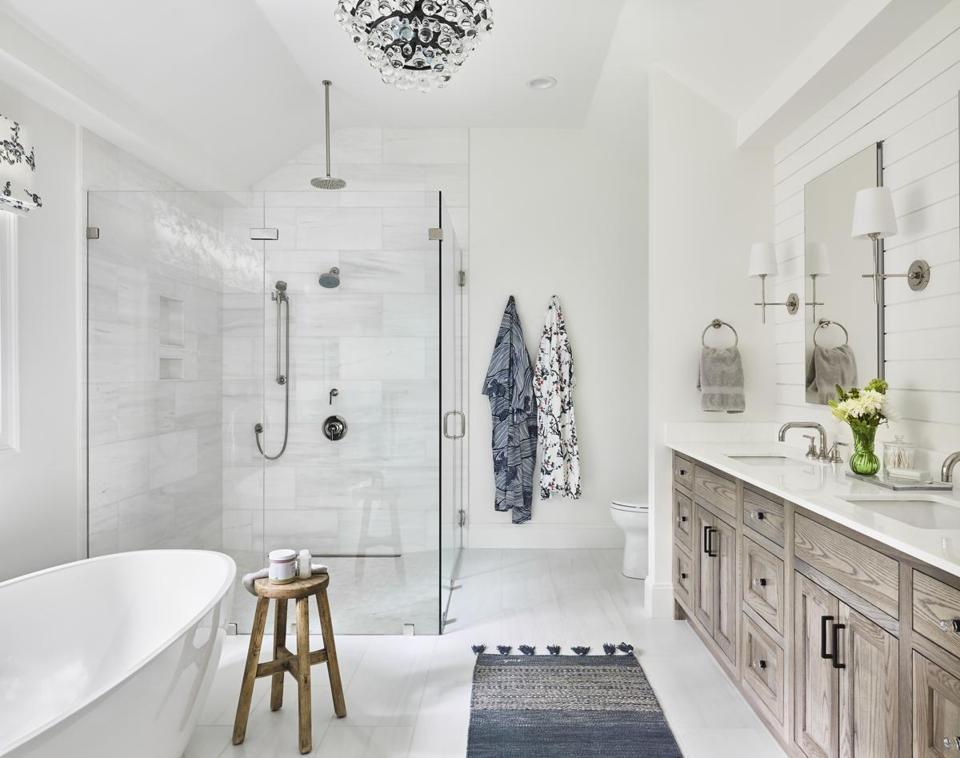 Below: The chandelier, by Robert Abbey, lends glamour to the master bath.