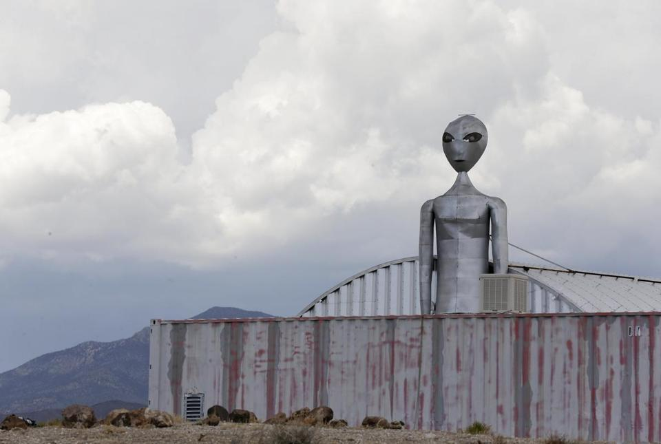 An alien sculpture looms over The Alien Research Center, a retail souvenir shop located near the military testing base known as Area 51, in Rachel, Nev.
