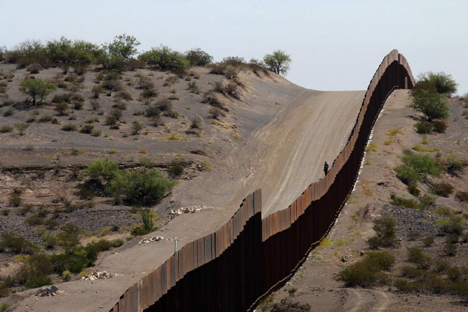 This picture taken on August 28, 2019 shows a portion of the wall on the US-Mexico border seen from Chihuahua State in Mexico (R), some 100 km from the city of Ciudad Juarez. - The US Defence Department said on September 3 it was freeing up $3.6 billion in funds budgeted for other projects to build a wall on the Mexican border as ordered by President Donald Trump. Six weeks after being confirmed by Congress, Defence Secretary Mike Esper has signed off on the diversion of funds, said Pentagon spokesman Jonathan Hoffmann. (Photo by HERIKA MARTINEZ / AFP)HERIKA MARTINEZ/AFP/Getty Images