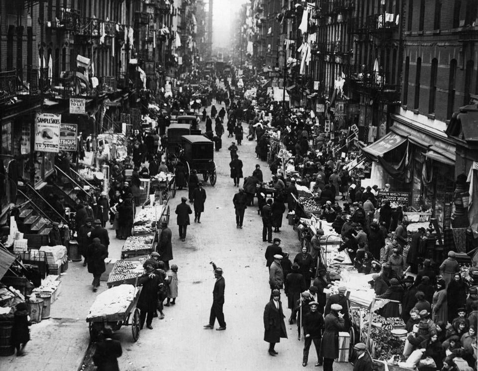The pushcart market in the East Side Ghetto of New York's Jewish Quarter is a hive of activity.