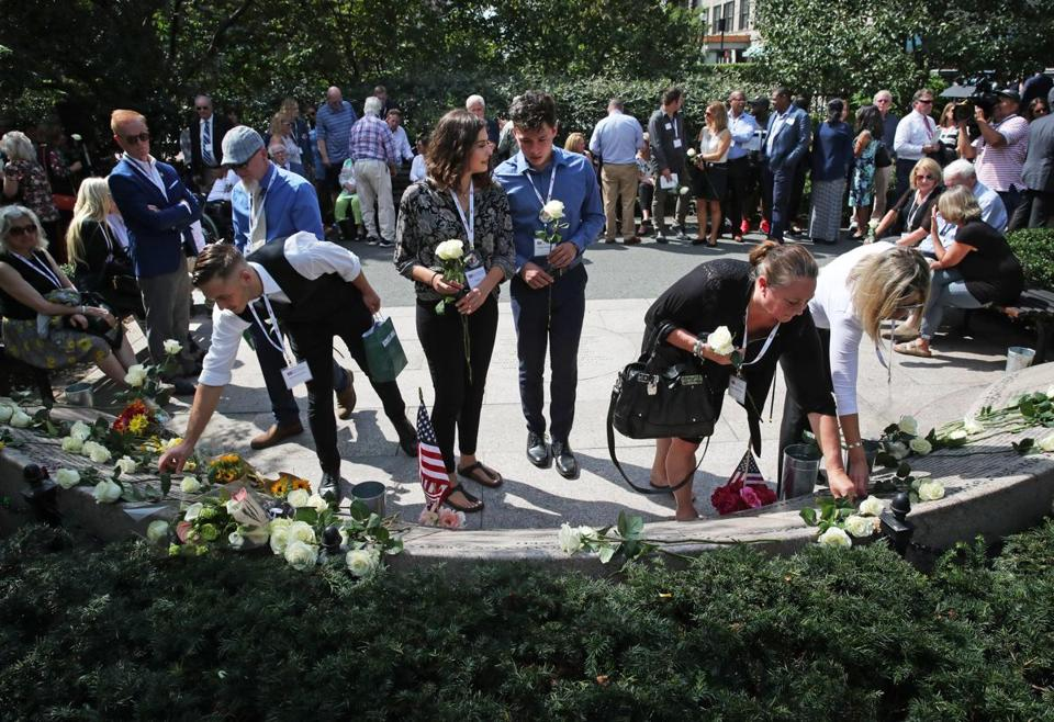 Family members of victims placed roses at the Public Garden.