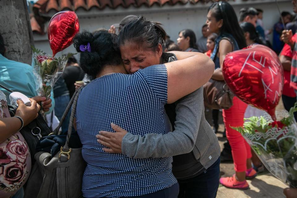 A woman deported from the United States was greeted by family in Guatemala City in August.