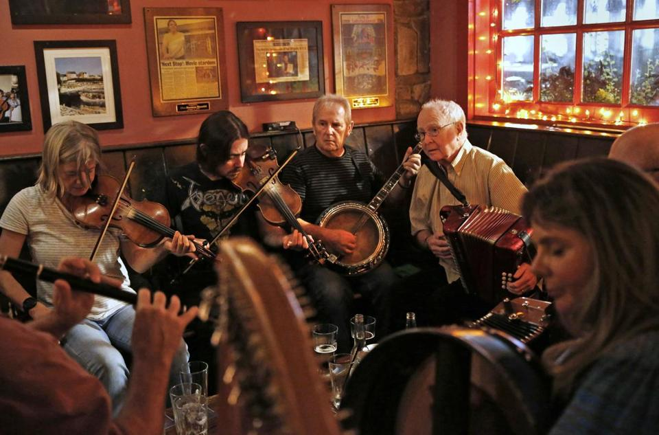 Somerville, MA, 09/16/2019 -- (L-R) Fiddler Alexandra Galperin plays beside fiddler Sean Connor, banjo player Terry O'Shea, and accordion player Tommy Sheridan during an Irish session at the Burren. (Jessica Rinaldi/Globe Staff) Topic: 17irishpubs Feature: