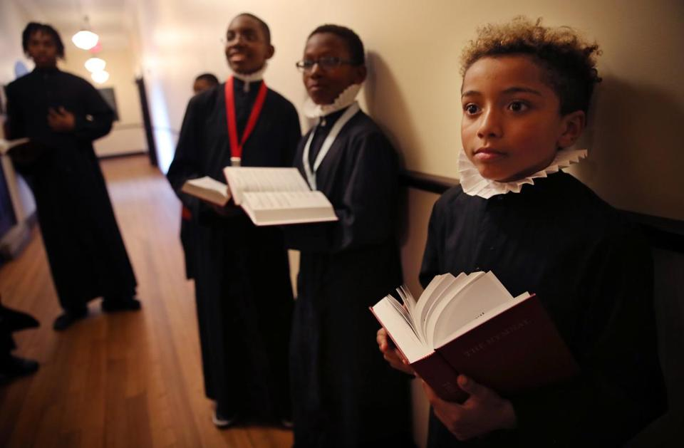 BOSTON, MA - SEPTEMBER 17, 2019: Shain Eddy, 9, right, listens to instruction during a rehearsal of the Ashmont Boy Choir at All Saints Church (Parish of All Saints) in Boston, MA on September 17, 2019. Members of the choir with be will be participating in the Ashmont Hill Chamber Music's season opening concert on Sunday. (Craig F. Walker/Globe Staff) section: Metro reporter: