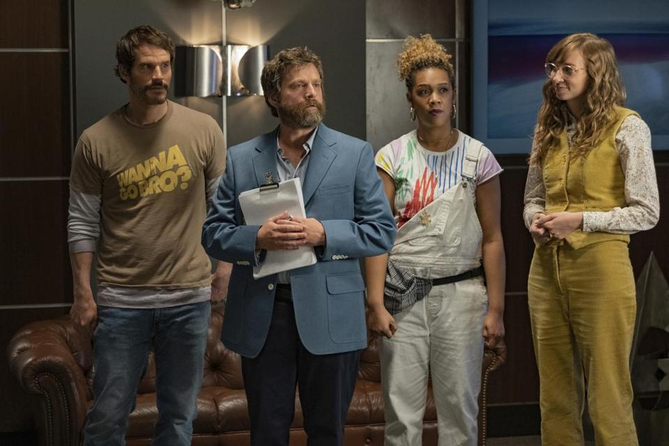 "This image released by Netflix shows Ryan Gaul, from left, Zach Galifianakis, Jiavani Linayao and Lauren Lapkus in ""Between Two Ferns: The Movie."" (Adam Rose/Netflix via AP)"