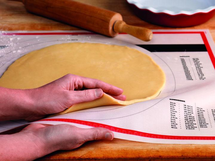 "02mat - The Silicone Pastry Mat by Tovolo, 18″ x 25"", with non-stick material and tear-resistant silicone fiber. Ruler and conversions are printed right on the mat. (David Bell/Tovolo and Spectrum Diversified Designs)"