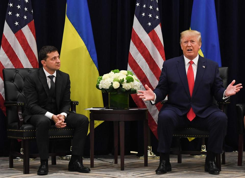 US President Donald Trump speaks as Ukrainian President Volodymyr Zelensky looks on during a meeting in New York on September 25, 2019, on the sidelines fo the United Nations General Assembly. (Photo by SAUL LOEB / AFP)SAUL LOEB/AFP/Getty Images