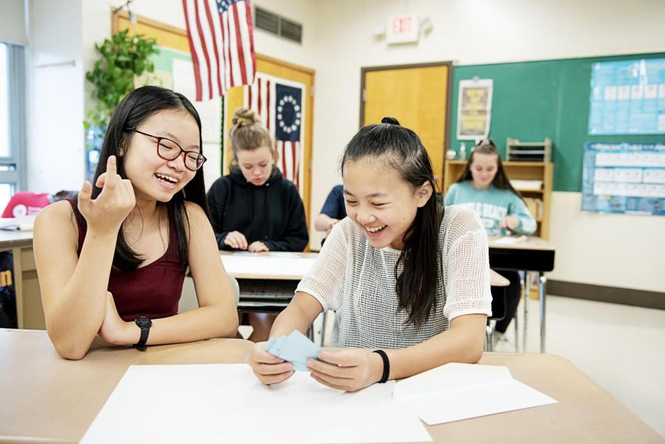 Linh Dieu (left) and Melody Chuong in civics class at Newton's Bigelow Middle School. For magazine story. Please don't use until mag story runs 10/6/19.