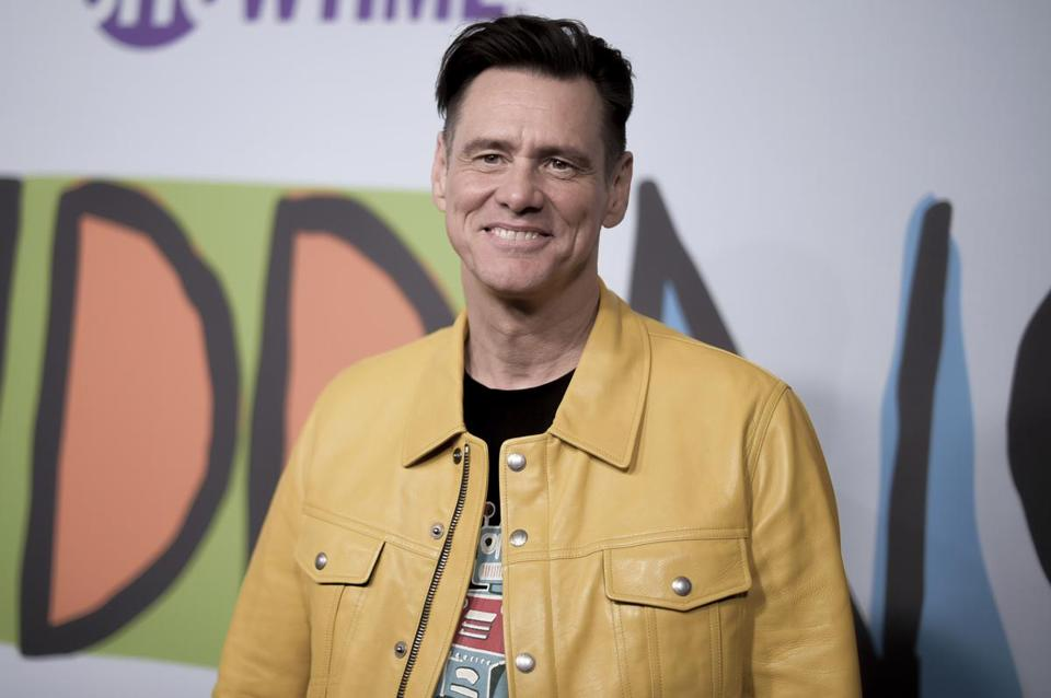 "FILE - In this Sept. 5, 2018 file photo, Jim Carrey attends the LA Premiere of ""Kidding ""at ArcLight Hollywood in Los Angeles. Carrey is working on a novel called ""Memoirs and Information,"" Alfred A. Knopf announced Wednesday, Oct. 2, 2019. Along with co-author Dana Vacjon, Carrey will take on celebrity, acting, romance and some other subjects he's familiar with. (Photo by Richard Shotwell/Invision/AP, File)"