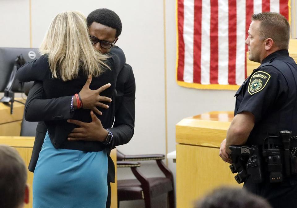 Brandt Jean hugged Amber Guyger, who was convicted in the murder of his brother, after she was sentenced Wednesday.