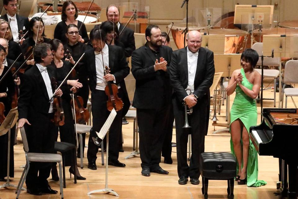 Conductor Andris Nelsons (center), principal trumpeter Thomas Rolfs, and pianist Yuja Wang after the performance Shostakovich's Piano Concerto No. 1 on Thursday.
