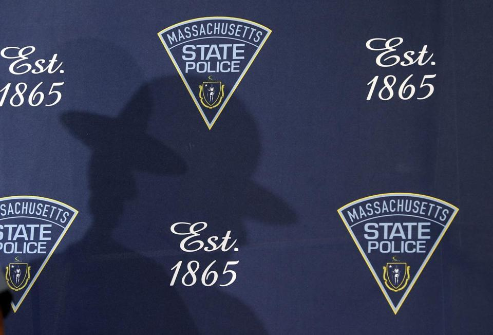 Charges were dropped in Wrentham District Court on Friday morning against the Massachusetts State Police trooper accused of exposing himself and punching a man at a Luke Bryan concert at Gillette Stadium in June, the Norfolk district attorney's office said.