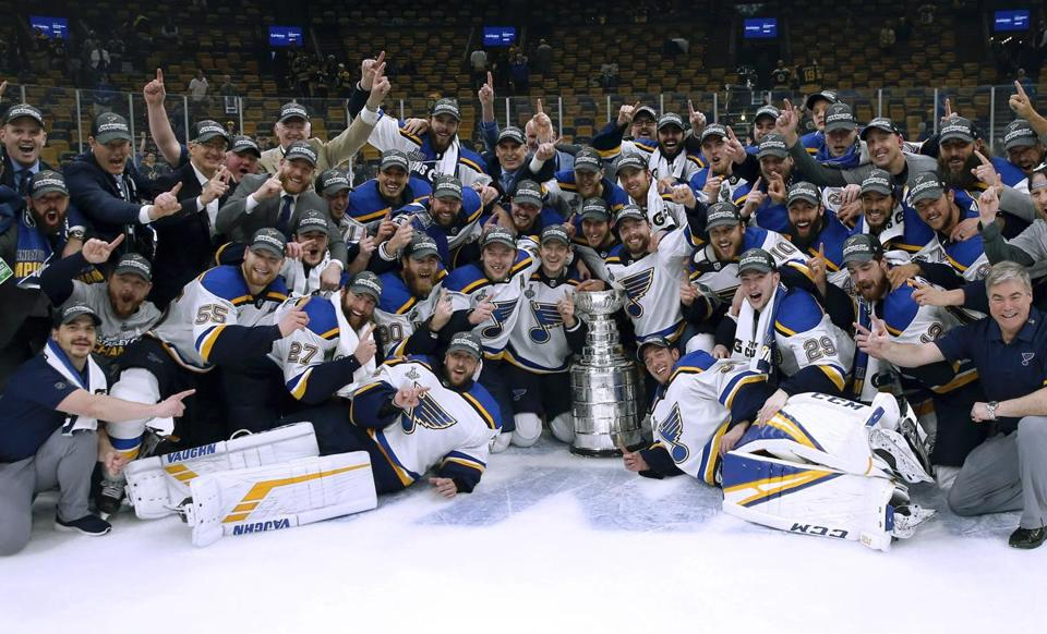 In this June 12, 2019, file photo, the St. Louis Blues celebrated with the Stanley Cup after they defeated the Boston Bruins in Game 7 of the NHL Stanley Cup Final in Boston. Now, the team is headed to the White House next week for a ceremony with President Trump.