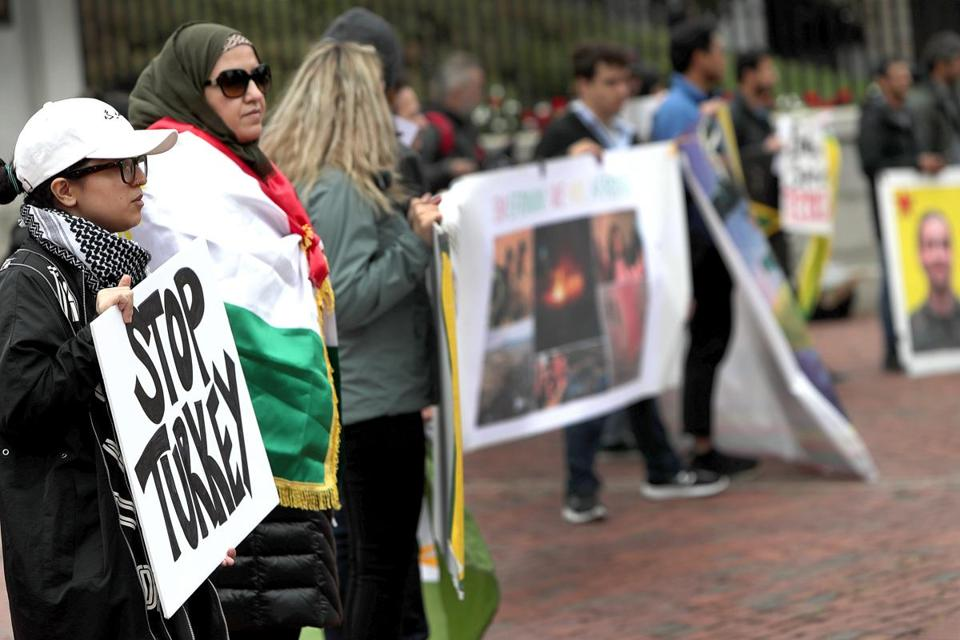 "More than 20 people attended the event, which featured a Kurdish flag and speakers playing Kurdish music, and people holding signs that said ""Free Kurdistan,"" ""Erdogan sponsors terrorism,"" and ""STOP TURKEY."""