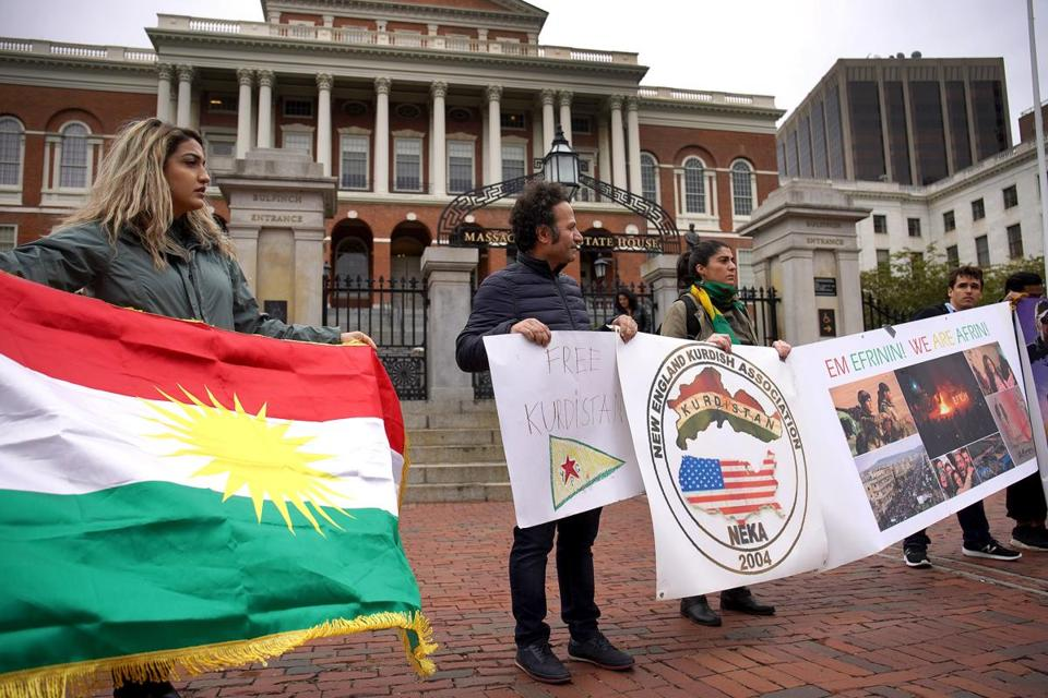 Two local Kurdish groups gathered at the State House to protest a Turkish military operation into northern Syria.