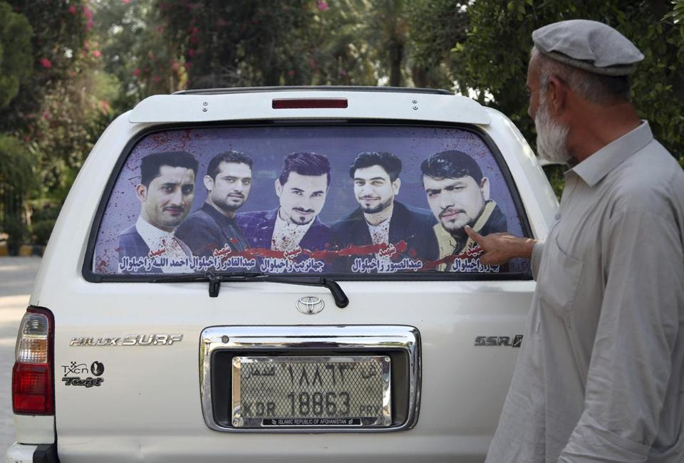 Mohammad Yaqoob Malikzada showed pictures on the back of his car of his brothers, who were killed during a raid by Afghan soldiers trained by the CIA. Anger is mounting over the increasing numbers of civilians dying in misdirected US aerial strikes and heavy-handed tactics of CIA-trained Afghan forces.