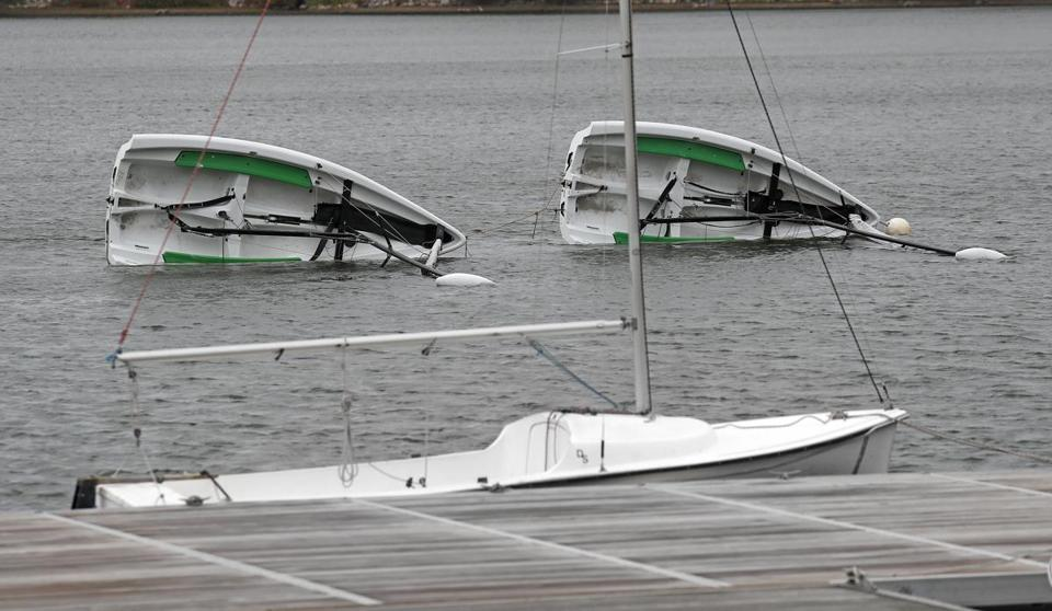 Sailboats in Jamaica Pond were turned upside down by the wind, but the first nor'easter of the season wasn't as fierce as promised.