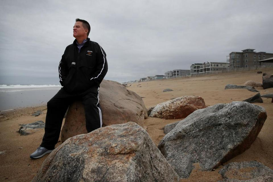 SALISBURY, MA - OCTOBER 22, 2019: Michael McCormack poses for a portrait at Salisbury Beach in Salisbury, MA on October 22, 2019. McCormack was diagnosed with younger-onset Alzheimer's disease almost five years ago, at age 54. He is a dedicated volunteer for the Alzheimer's Association MA/NH Chapter, and serves on the Board of Directors. Michael said he walks about 4.5 miles a day. He said he texts his wife before he leaves and when he returns, plus he can always see their condominium during his loop. (Craig F. Walker/Globe Staff) section: Metro reporter: