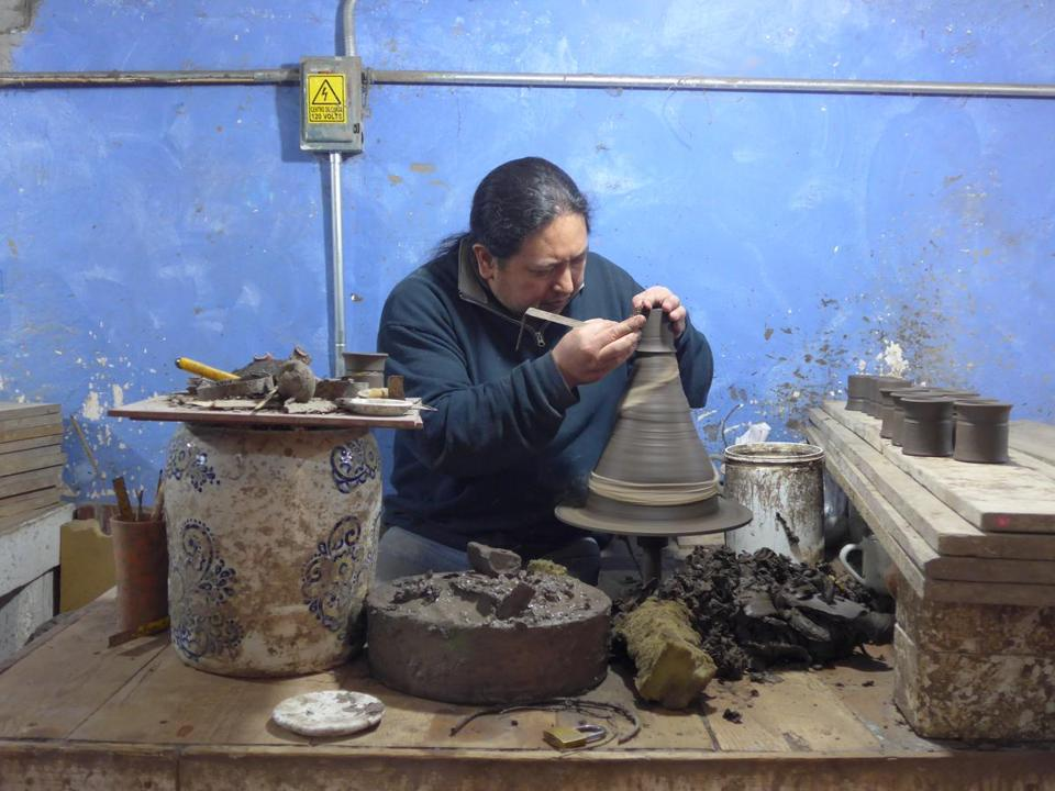 A worker shapes a piece at Uriarte Talavera, a ceramics company started in 1824.