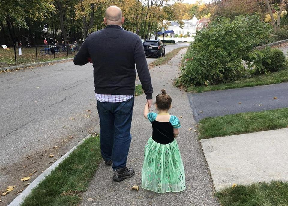 The columnist and his daughter, only one of whom is wearing cap sleeves.