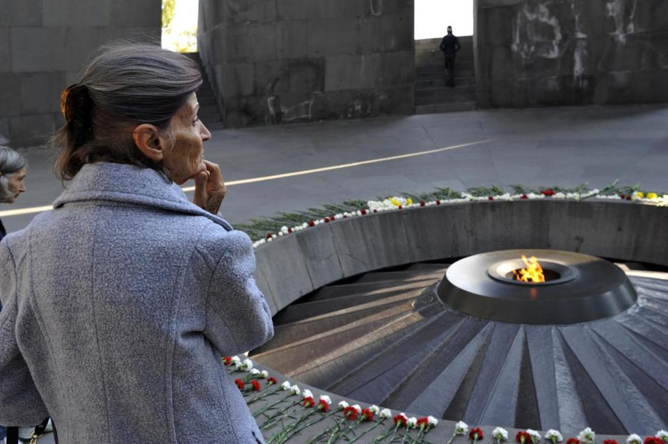 A woman stands at the Tzitzernakaberd memorial to the victims of mass killings by Ottoman Turks, in the Armenian capital Yerevan, Armenia, on Wednesday. The US House of Representatives voted overwhelmingly on Tuesday to recognize the century-old mass killings of Armenians by Ottoman Turks as genocide.
