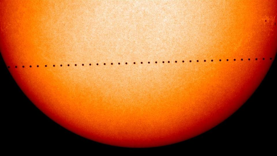 A composite image from the 2006 transit of Mercury across the sun. as captured by the Solar and Heliospheric Observatory. This time around, it will carve a more central path across the face of the star.