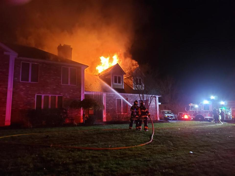 Firefighters responded to a house fire at 6 Weathervane Road in Canton early Monday morning.