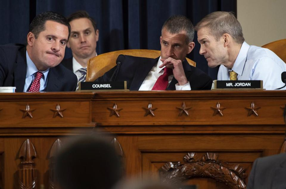 Representative Devin Nunes, left, spoke with Representative Jim Jordan, right, and Steve Castor, Republican staff counsel during Wednesday's hearing.