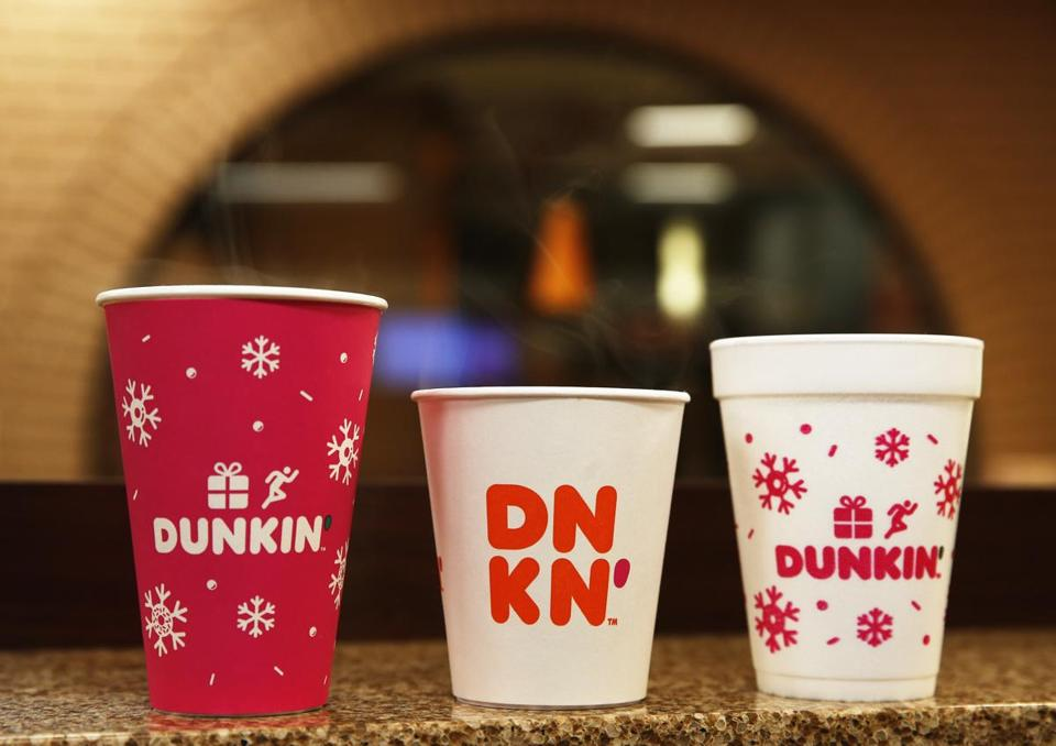 The foam cup (right), a bane of environmentalists, is being replaced by double-walled paper cups (left and center).