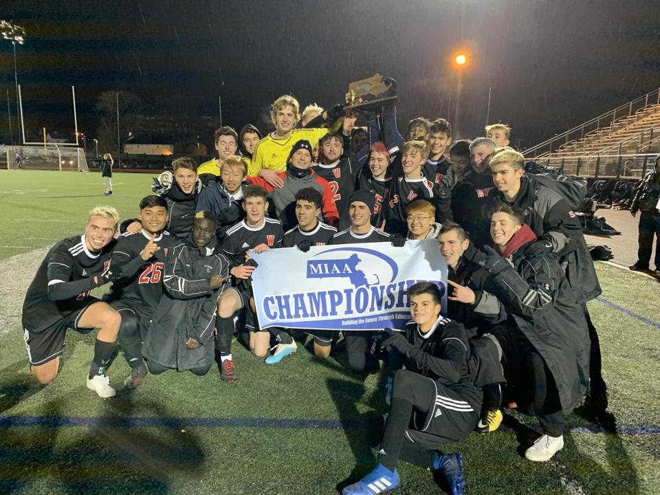 1The Winchester boys' soccer team poses with the championship hardware after their 1-0 win over Concord-Carlisle in the D2 North title game Sunday night in Lynn.