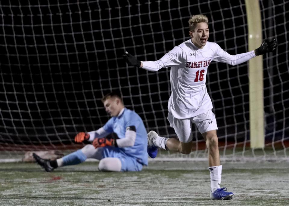 Gabriel Godoy triggered Milford's celebration with his winning shootout goal against Nauset goalie Jack Avellar.