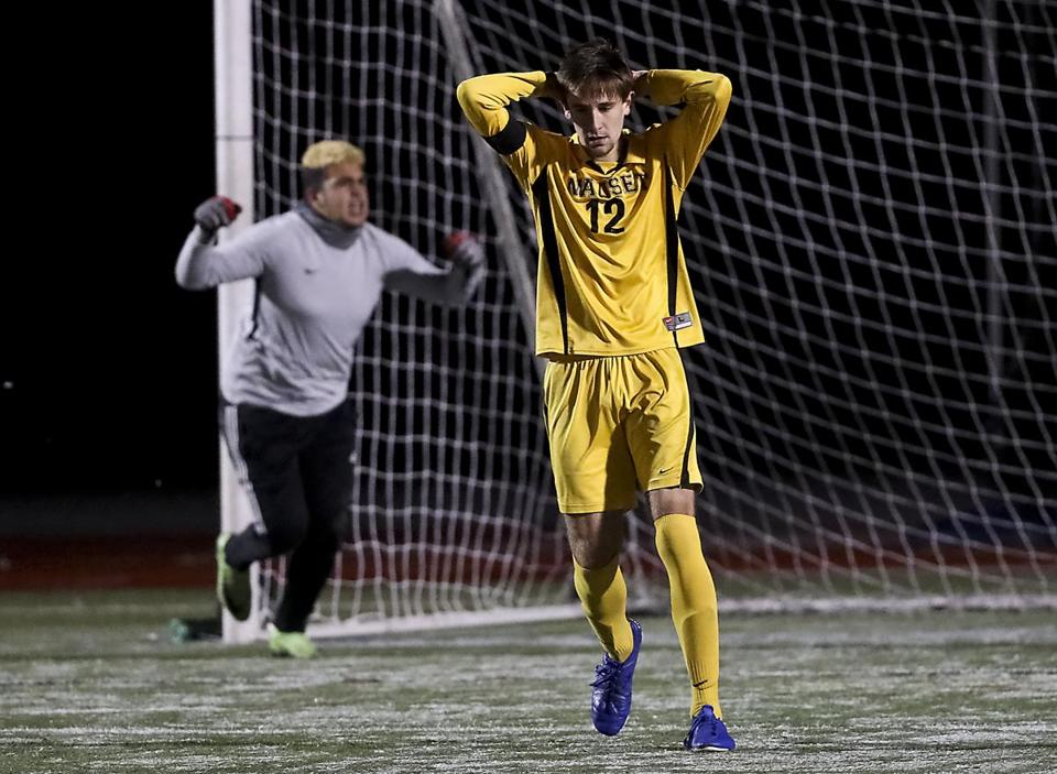 The ecstasy and the agony are reflected in the reactions of Milford goalie Leo Oliveira after he denied Nauset's Spencer Rushnak (12) shootout goal attempt in the D2 South sectional final at Milford High.