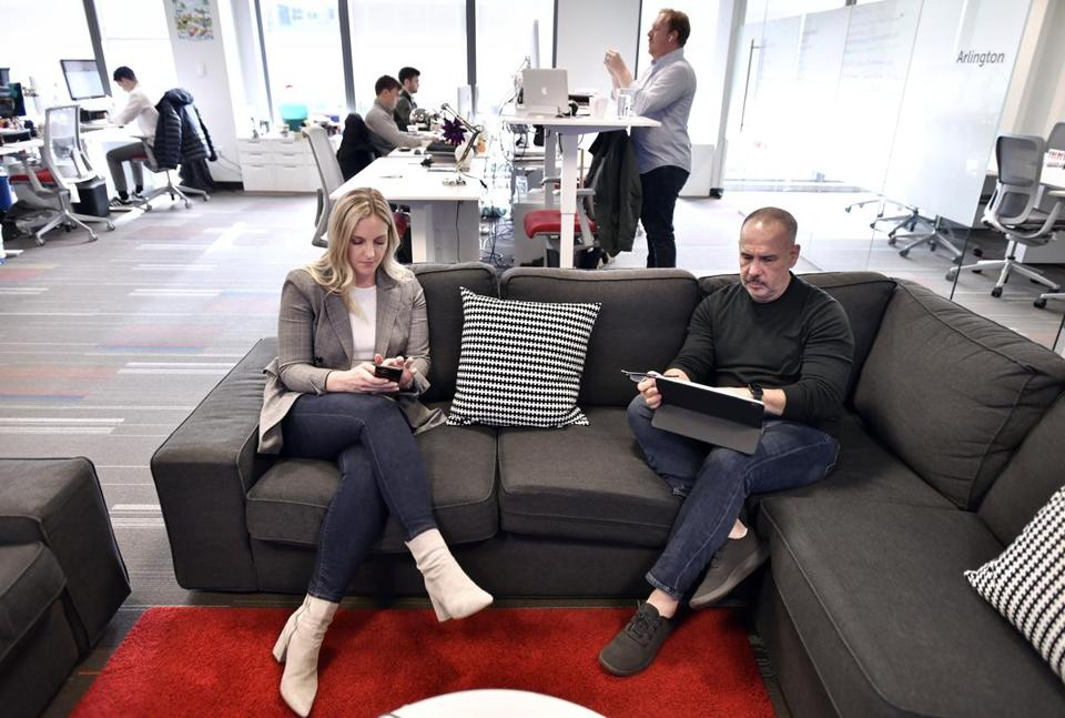 From left, Director of Corporate Communications Casey Antonelli, and Chief Marketing Officer Philip Granof, right, at Boston startup NewStore, which makes software to support ecommerce.