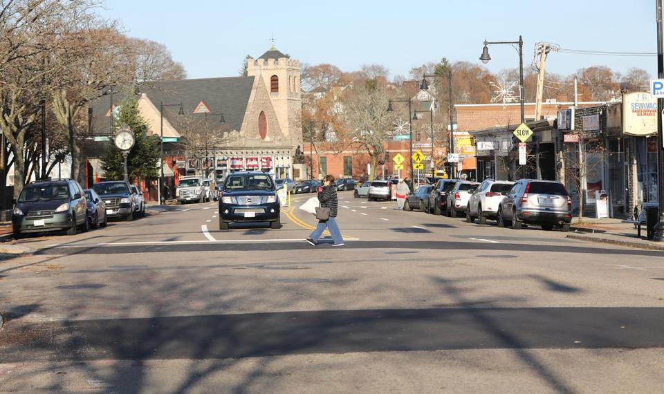 A proposal would reduce the number of lanes on Centre Street in West Roxbury from four to two and taking away about 16 of 221 parking spaces in various places along the street.